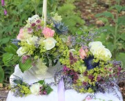 Table centrepiece and bridal bouquet with deep sapphire coloured eryngiums